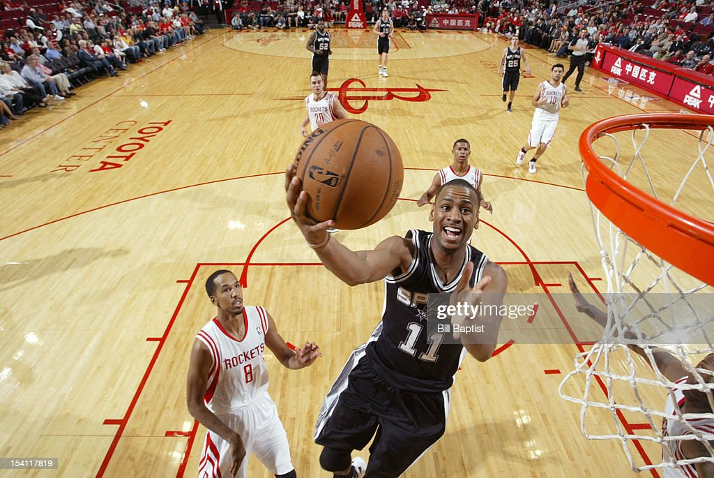 Wesley Witherspoon #11 of the San Antonio Spurs shoots the ball over Shaun Livingston #8 of the Houston Rockets during a pre-season game on October 14, 2012 at the Toyota Center in Houston, Texas.