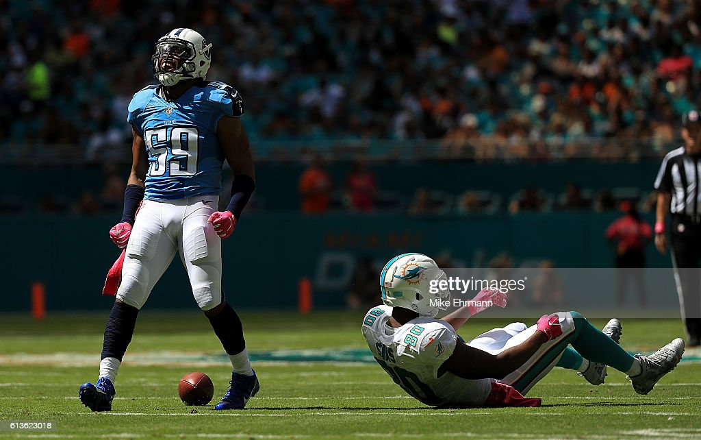 Wesley Woodyard of the Tennessee Titans reacts to a play during a game against the Miami Dolphins on October 9 2016 in Miami Gardens Florida