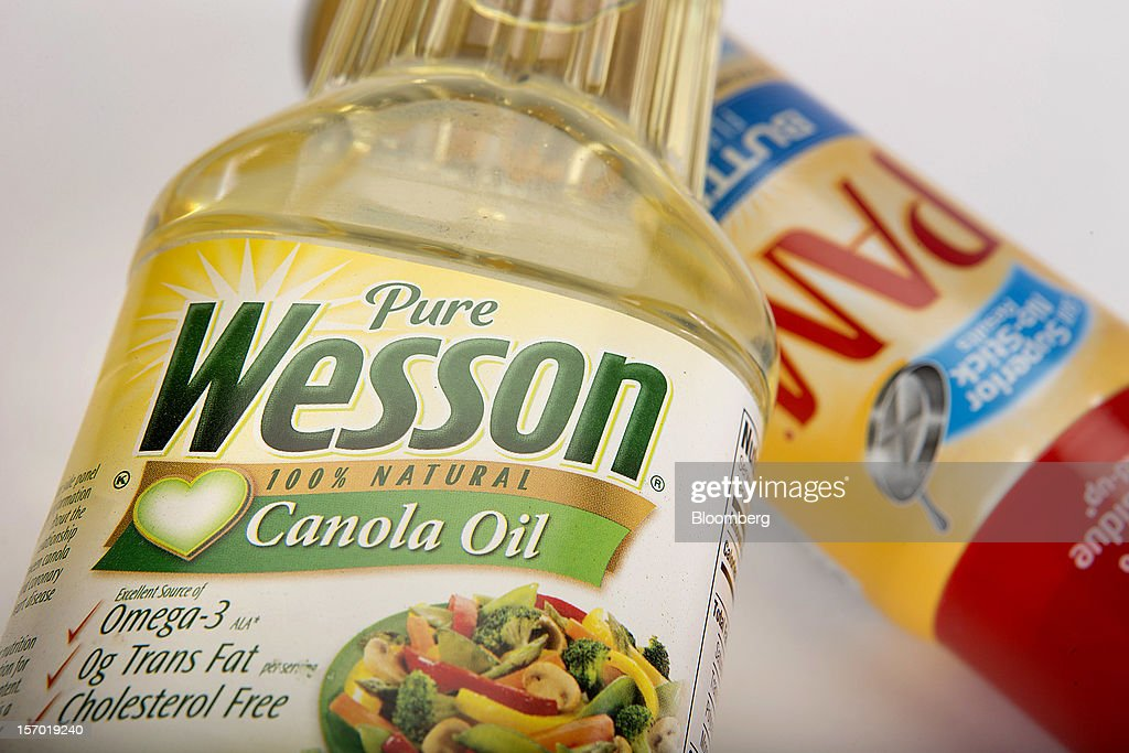 Wesson Canola oil and Pam non-stick spray, both food products made by ConAgra Foods Inc., are arranged for a photograph in New York, U.S., on Tuesday, Nov. 27, 2012. ConAgra Foods Inc. agreed to acquire Ralcorp Holdings Inc. for about $5 billion, creating one of the largest packaged food companies in North America and concluding a pursuit that included three rejections since March last year. Photographer: Scott Eells/Bloomberg via Getty Images