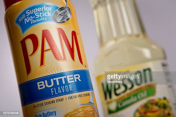 Wesson Canola oil and Pam nonstick spray both food products made by ConAgra Foods Inc are arranged for a photograph in New York US on Tuesday Nov 27...