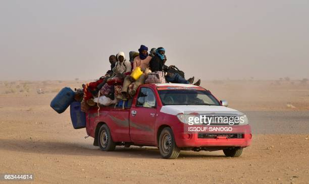 West African people coming back to Niger after fleeing Libya due to armed groups arrive on a pick up in Agadez northern Niger on March 31 following...