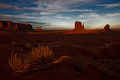 West and East Mitten buttes inside the Monument Valley Tribal Park at sunset The parked is owned and operated by the Navajo people