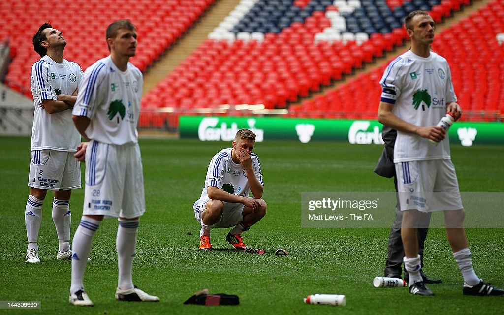 West Auckland Town players look on, after losing to Dunston UTS during the FA Carlsberg Vase Final between Dunston UTS and West Auckland Town at Wembley Stadium on May 13, 2012 in London, England.