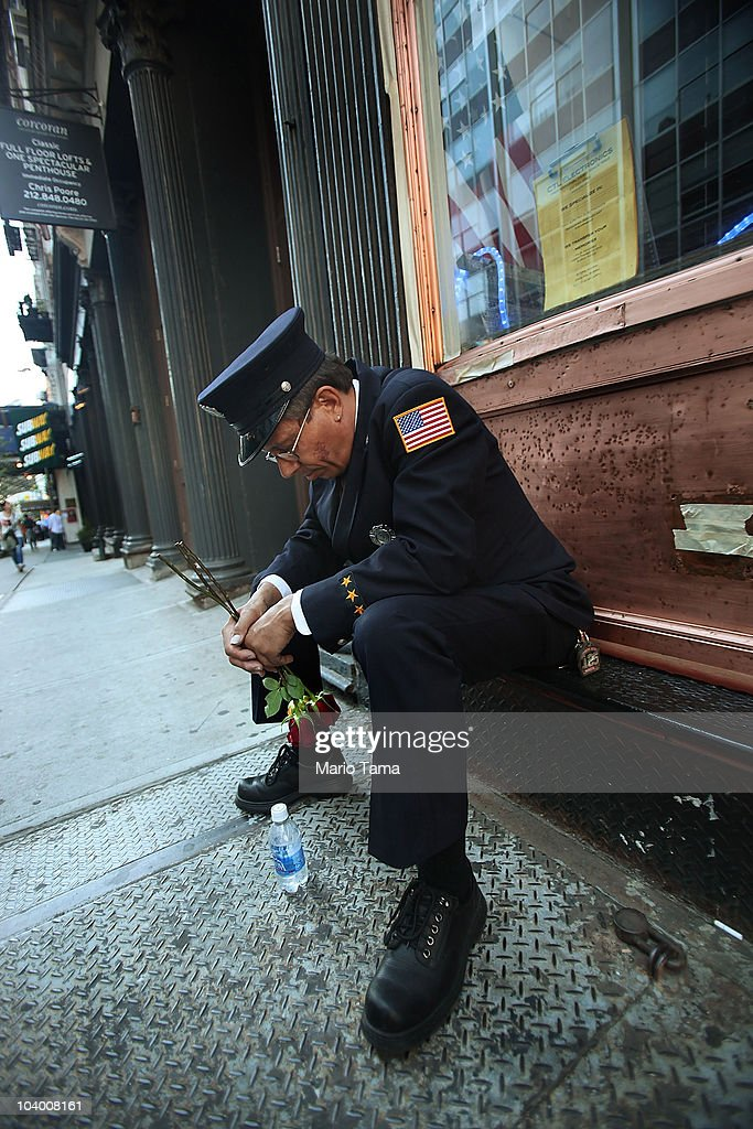 West Babylon Fire Department firefighter Hassan Hamza bows his head after 9/11 commemorations outside the World Trade Center site on September 11...