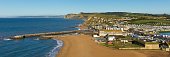 West Bay Dorset England uk small town on Jurassic coast south of Bridport on a beautiful day with blue sky and sea