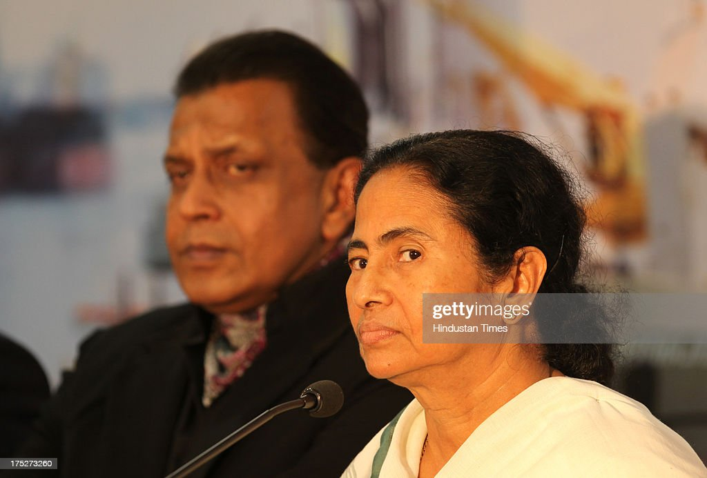 West Bengal Chief Minister Mamata Banerjee and Bollywood actor Mithun Chakraborty during a press conference after the investors summit at World Trade Centre on August 1, 2013 in Mumbai, India. Ms Banerjee met with about 40 top industry leaders and said that West Bengal is now more investment friendly as the work culture has improved and the number of manhours lost due to strikes has declined. She also said that West Bengal government has framed a detailed land use policy and created a 10,000 acre land-bank for industrial purposes apart from creating 'an employment bank'.