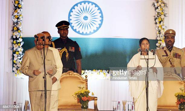 West Bengal Chief Minister Mamata Banerjee being administered oath by Governor Kesri Nath Tripathi at Red Road on May 27 2016 in Kolkata India The...