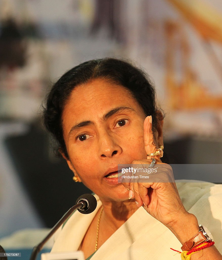 West Bengal Chief Minister Mamata Banerjee during a press conference after the investors summit at World Trade Centre on August 1, 2013 in Mumbai, India. Ms Banerjee met with about 40 top industry leaders and said that West Bengal is now more investment friendly as the work culture has improved and the number of manhours lost due to strikes has declined. She also said that West Bengal government has framed a detailed land use policy and created a 10,000 acre land-bank for industrial purposes apart from creating 'an employment bank'.