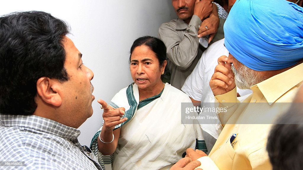 West Bengal chief Minister Mamata Banerjee express her anger to Deputy chairman Planning commission Montec Singh Ahluwalia and Parliamentary affairs Minster Rajiv Shukla over the manhandling of her finance minister Amit Mitra by protesting SFI Members outside Planning Commission during meeting for the discussion on the annual plan 2013-14 of the state at Planning Commission on April 9, 2013 in New Delhi, India. The SFI Members were protesting against the death of SFI student leader Sudipto Gupta in police crackdown earlier this month.