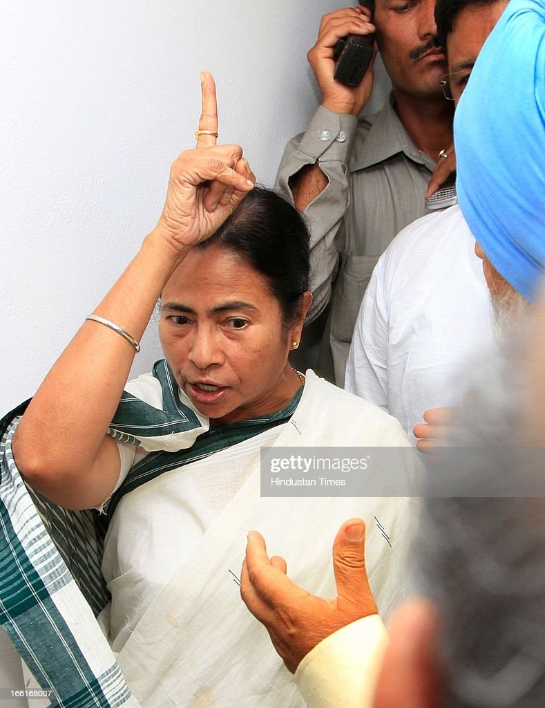 West Bengal chief Minister Mamata Banerjee express her anger to Deputy chairman Planning commission Montec Singh Ahluwalia over the manhandling of her finance minister Amit Mitra by protesting SFI Members outside Planning Commission during meeting for the discussion on the annual plan 2013-14 of the state at Planning Commission on April 9, 2013 in New Delhi, India. The SFI Members were protesting against the death of SFI student leader Sudipto Gupta in police crackdown earlier this month.