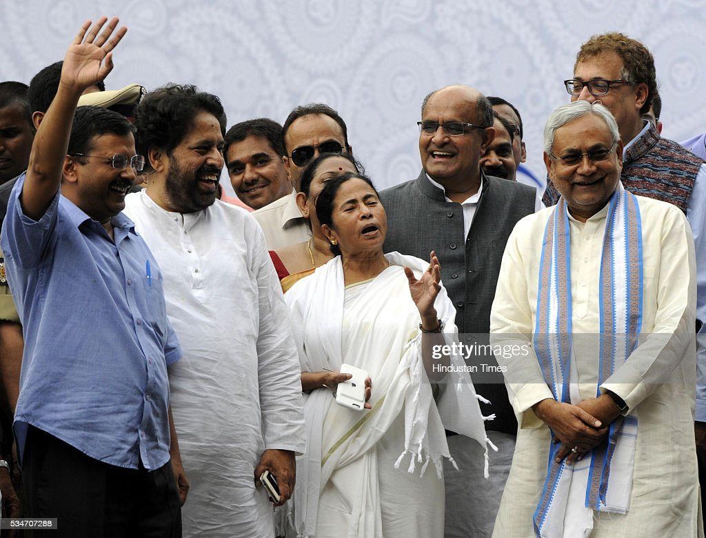West Bengal Chief Minister Mamata Banerjee with Delhi Chief Minister Arvind Kejriwal and Bihar Chief Minister Nitish Kumar during her Swearing in ceremony at Red Road on May 27, 2016 in Kolkata, India. Mamata Banerjee was sworn in on West Bengal's chief minister for a second term alongwith 41 ministers. The presence of prominent Non-BJP Non-Congress party leaders like Arvind Kejriwal, Nitish Kumar, Lalu Yadav, Akhilesh Yadav gave air to formation of major Anti-Modi block in 2019.