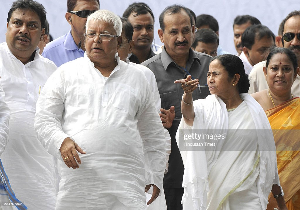 West Bengal Chief Minister Mamata Banerjee with Delhi Chief Minister RJD chief Lalu Yadav during her Swearing in ceremony at Red Road on May 27, 2016 in Kolkata, India. Mamata Banerjee was sworn in on West Bengal's chief minister for a second term alongwith 41 ministers. The presence of prominent Non-BJP Non-Congress party leaders like Arvind Kejriwal, Nitish Kumar, Lalu Yadav, Akhilesh Yadav gave air to formation of major Anti-Modi block in 2019.