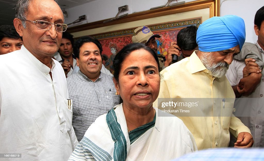 West Bengal chief Minister Mamata Banerjee with her Finance minister Amit Mitra, chairman Planning commission Montec Singh Ahluwalia and Parliamentary affairs Minster Rajiv Shukla during meeting for the discussion on the annual plan 2013-14 of the state at Planning Commission on April 9, 2013 in New Delhi, India. West Bengal finance minister Amit Mitra was manhandled by protesting SFI Members outside Planning Commission. The SFI Members were protesting against the death of SFI student leader Sudipto Gupta in police crackdown earlier this month.