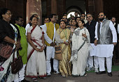 West Bengal Chief Minister Mamata Banerjee with her Party MPs at Parliament during Budget session on March 9 2015 in New Delhi India Members in both...