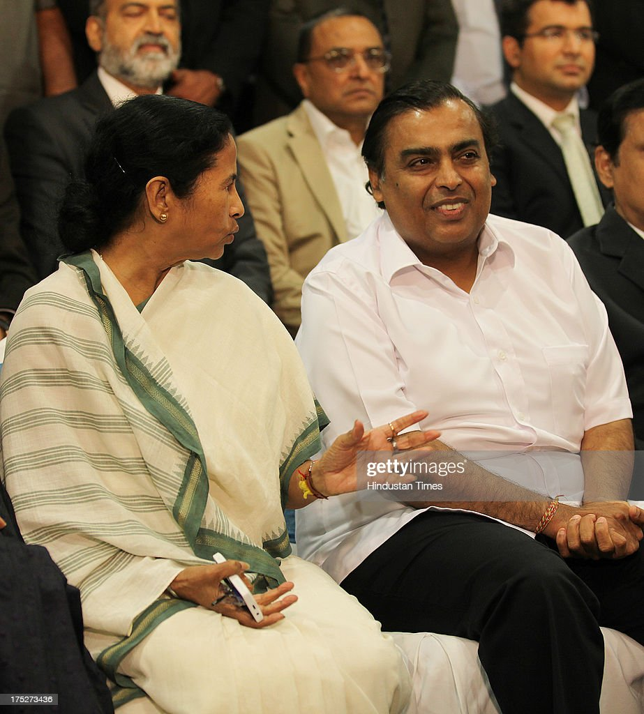 West Bengal Chief Minister Mamata Banerjee with Reliance Industry Chairman Mukesh Ambani, during the investors summit at World Trade Centre in Mumbai, India on Thursday August 01, 2013.