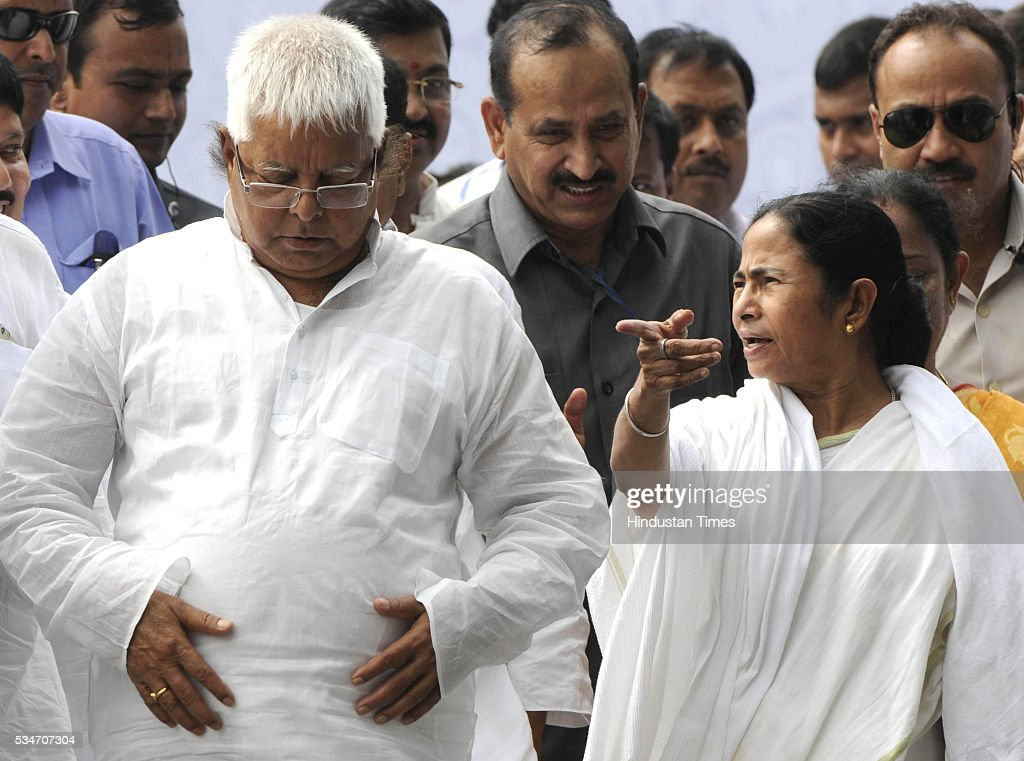 West Bengal Chief Minister Mamata Banerjee with RJD Chief Lalu Yadav during her Swearing in ceremony at Red Road on May 27, 2016 in Kolkata, India. Mamata Banerjee was sworn in on West Bengal's chief minister for a second term alongwith 41 ministers. The presence of prominent Non-BJP Non-Congress party leaders like Arvind Kejriwal, Nitish Kumar, Lalu Yadav, Akhilesh Yadav gave air to formation of major Anti-Modi block in 2019.