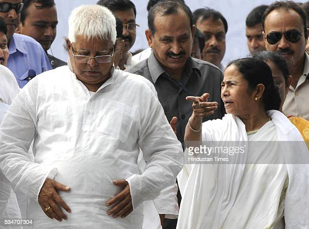 West Bengal Chief Minister Mamata Banerjee with RJD Chief Lalu Yadav during her swearingin ceremony at Red Road on May 27 2016 in Kolkata India...