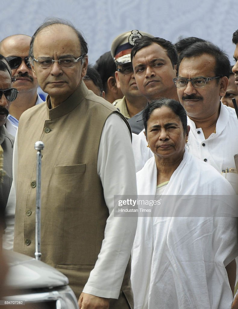 West Bengal Chief Minister Mamata Banerjee with Union Finance Minister Arun Jaitley during her Swearing in ceremony at Red Road on May 27, 2016 in Kolkata, India. Mamata Banerjee was sworn in on West Bengal's chief minister for a second term alongwith 41 ministers. The presence of prominent Non-BJP Non-Congress party leaders like Arvind Kejriwal, Nitish Kumar, Lalu Yadav, Akhilesh Yadav gave air to formation of major Anti-Modi block in 2019.