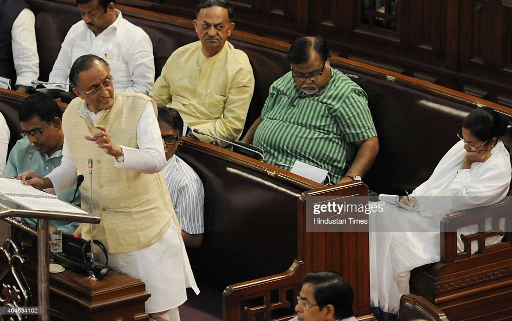 West Bengal State Finance Minister Amit Mitra is presenting Budget for 2015 with Chief Minister <a gi-track='captionPersonalityLinkClicked' href=/galleries/search?phrase=Mamata+Banerjee&family=editorial&specificpeople=585449 ng-click='$event.stopPropagation()'>Mamata Banerjee</a> at Assembly on February 27, 2015 in Kolkata, India. The revised tax collection is Rs 40,062 crore for 2014-15 against the budgeted estimate of Rs 45,413 crore.
