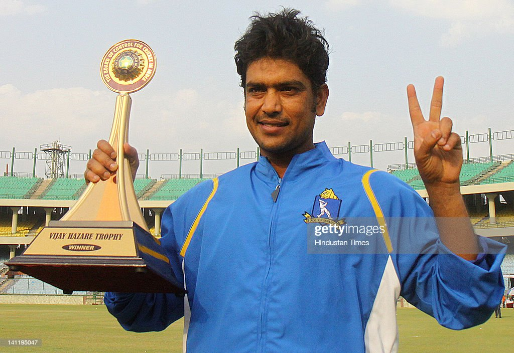 West Bengal's Laxmi Ratan Shukla poses with the Vijay Hazare Trophy after winning the final against Mumbai at Ferozshah Kotla on March 12, 2012 in New Delhi, India. After restricting the Mumbai team to 248 all out, West Bengal made short of the score with 23 balls to spare and six wickets in hands.