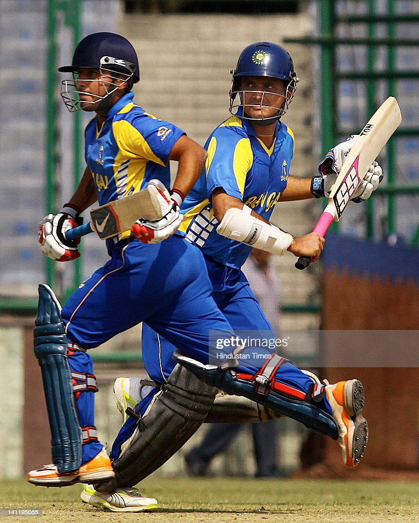 West Bengal's Shreevats Pratyush Goswami (L) and Saurabh Ganguly taking a run during the Vijay Hazare Trophy final played between Mumbai and West Bengal at Ferozshah Kotla on March 12, 2012 in New Delhi, India. After restricting Mumbai team to 248 all out, West Bengal made short of the score with 23 balls to spare and six wickets in hands.