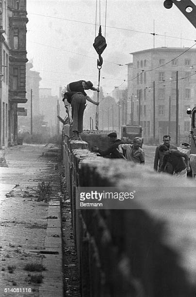 9/27/1961 West Berlin Germany Going up East Berlin police build the wall that divides the city higher September 25 as border incidents continue to...