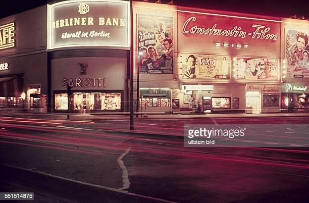 West Berlin neon signs at Cafe Kranzler Eck and advertising for Constantin Film production at Kurfuerstendamm in Berlin Charlottenburg