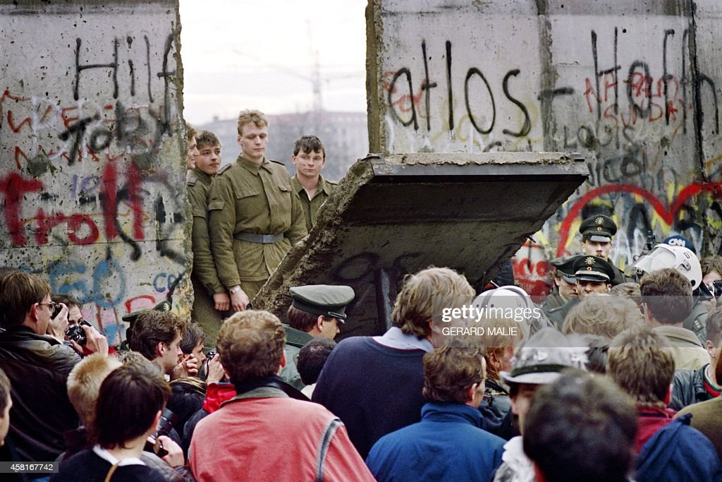 West Berliners crowd in front of the Berlin Wall early 11 November 1989 as they watch East German border guards demolishing a section of the wall in order to open a new crossing point between East and West Berlin, near the Potsdamer Square. Two days before, Gunter Schabowski, the East Berlin Communist party boss, declared that starting from midnight, East Germans would be free to leave the country, without permission, at any point along the border, including the crossing-points through the Wall in Berlin. The Berlin concrete wall was built by the East German government in August 1961 to seal off East Berlin from the part of the city occupied by the three main Western powers to prevent mass illegal immigration to the West. According to the 'August 13 Association' which specialises in the history of the Berlin Wall, at least 938 people - 255 in Berlin alone - died, shot by East German border guards, attempting to flee to West Berlin or West Germany.