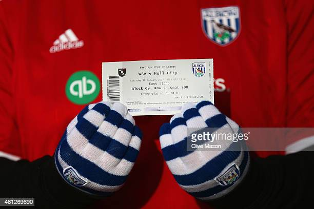 West Brom fan shows a match ticket prior to the Barclays Premier League match between West Bromwich Albion and Hull City at The Hawthorns on January...