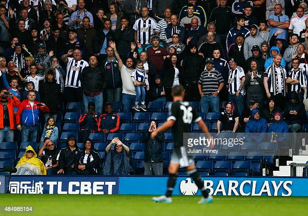 West Brom fans wave as John Terry of Chelsea is sent off during the Barclays Premier League match between West Bromwich Albion and Chelsea at The...