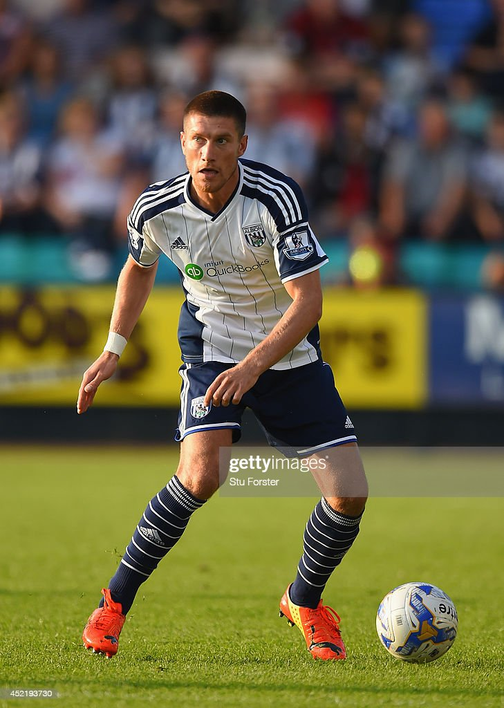 West Brom new signing <a gi-track='captionPersonalityLinkClicked' href=/galleries/search?phrase=Sebastien+Pocognoli&family=editorial&specificpeople=3942105 ng-click='$event.stopPropagation()'>Sebastien Pocognoli</a> in action during a pre season friendly between Shrewsbury Town and West Bromwich Albion at Greenhous Meadow on July 15, 2014 in Shrewsbury, England.