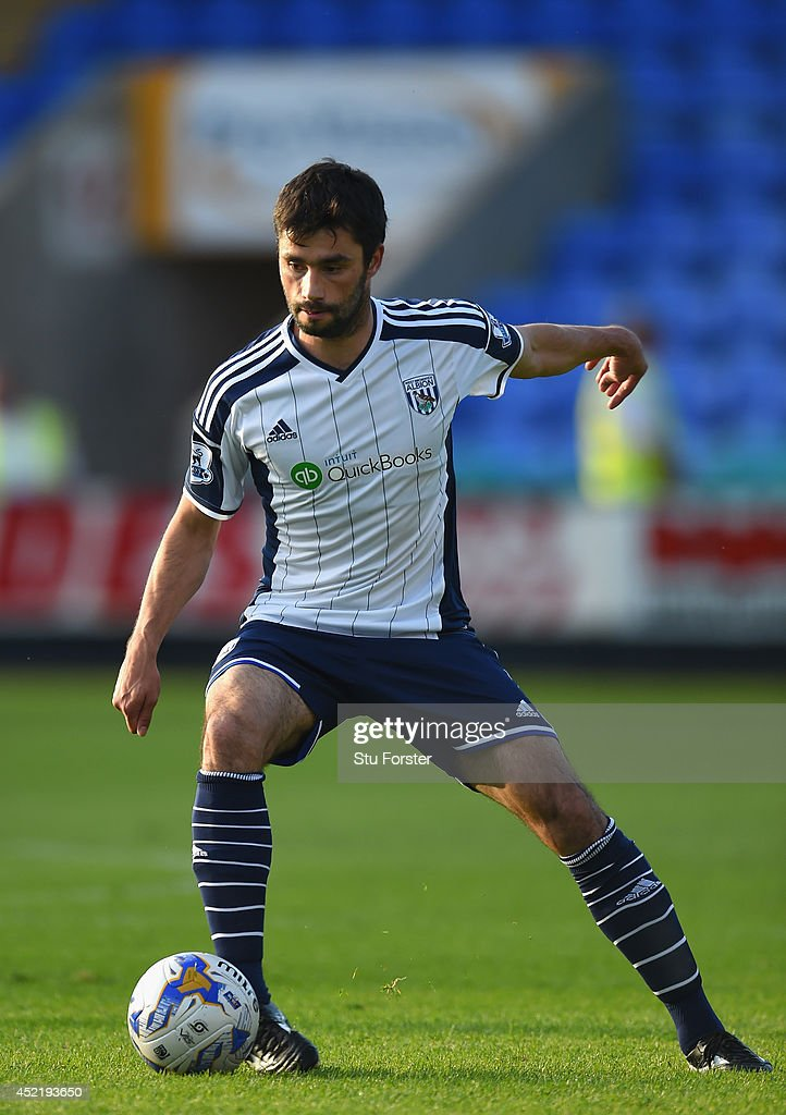 West Brom player <a gi-track='captionPersonalityLinkClicked' href=/galleries/search?phrase=Claudio+Yacob&family=editorial&specificpeople=4104249 ng-click='$event.stopPropagation()'>Claudio Yacob</a> in action during a pre season friendly between Shrewsbury Town and West Bromwich Albion at Greenhous Meadow on July 15, 2014 in Shrewsbury, England.