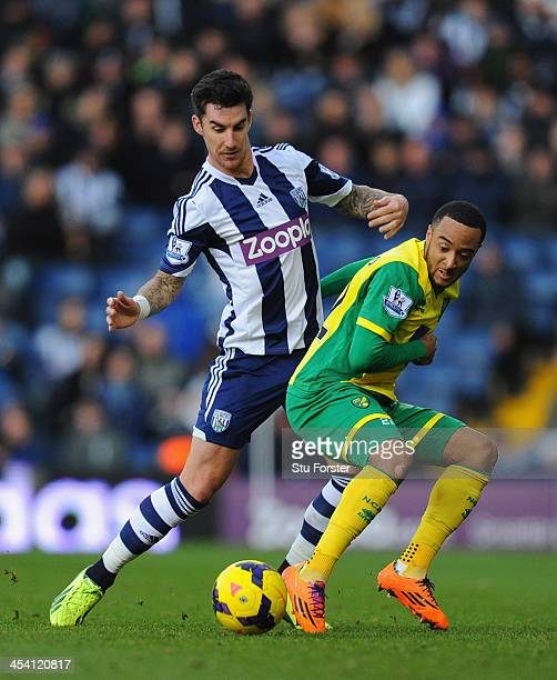 West Brom player Liam Ridgewell attempts to halt Norwich player Nathan Redmond during the Barclays Premier League match between West Bromwich Albion...