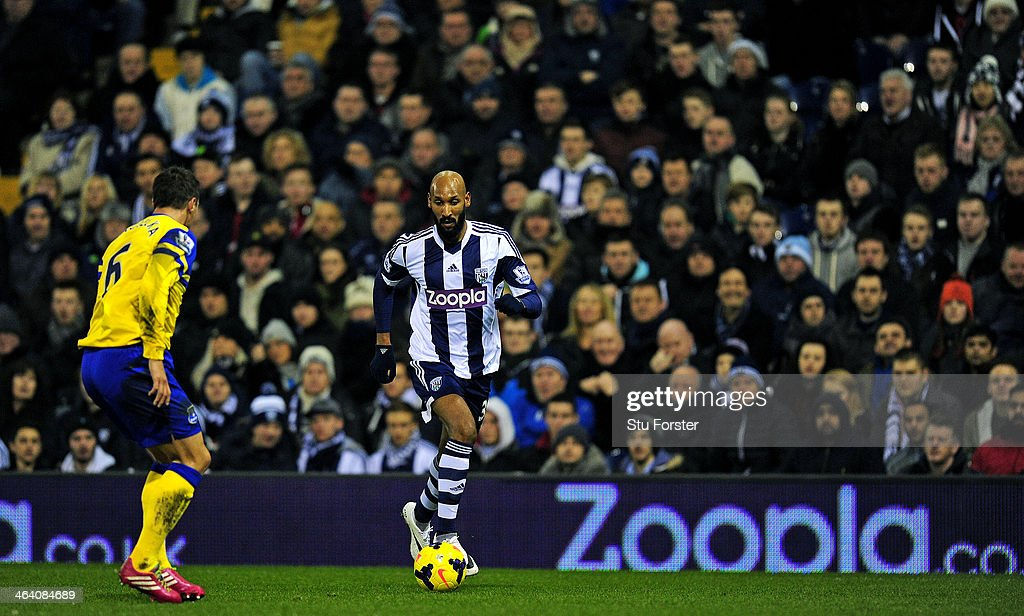 West Brom player <a gi-track='captionPersonalityLinkClicked' href=/galleries/search?phrase=Nicolas+Anelka&family=editorial&specificpeople=206204 ng-click='$event.stopPropagation()'>Nicolas Anelka</a> (r) in action infront of a Zoopla sign during the Barclays premier league match between West Bromwich Albion and Everton at The Hawthorns on January 20, 2014 in West Bromwich, England.