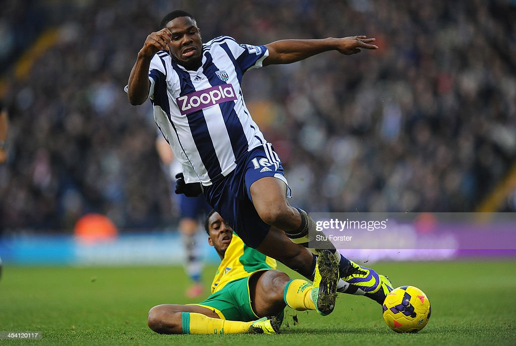 West Brom player <a gi-track='captionPersonalityLinkClicked' href=/galleries/search?phrase=Victor+Anichebe&family=editorial&specificpeople=740464 ng-click='$event.stopPropagation()'>Victor Anichebe</a> (r) is tackled by Norwich player Leroy Fer during the Barclays Premier League match between West Bromwich Albion and Norwich City at The Hawthorns on December 7, 2013 in West Bromwich, England.