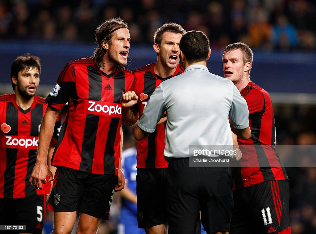 West Brom trio Jonas Olsson, Gareth McAuley and <a gi-track='captionPersonalityLinkClicked' href=/galleries/search?phrase=Chris+Brunt&family=editorial&specificpeople=809047 ng-click='$event.stopPropagation()'>Chris Brunt</a> appeal to referee Andre Marriner after he awards a late penalty to Chelsea during the Barclays Premier League match between Chelsea and West Bromwich Albion at Stamford Bridge on November 09, 2013 in London, England.