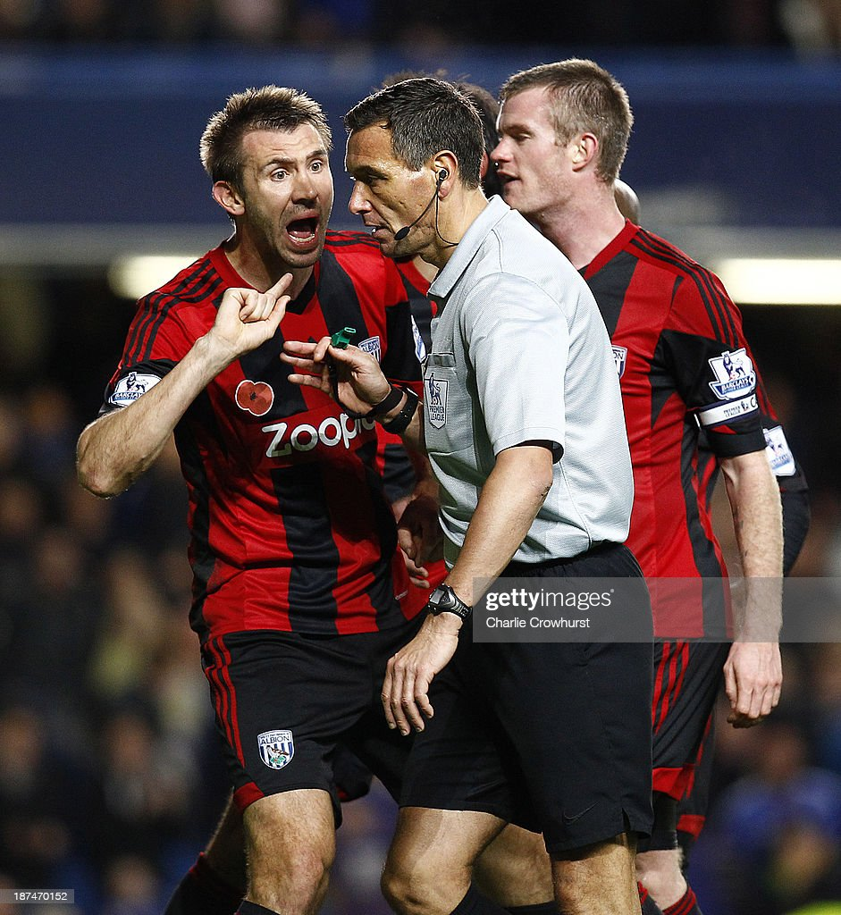 West Brom's Gareth McAuley appeals to referee <a gi-track='captionPersonalityLinkClicked' href=/galleries/search?phrase=Andre+Marriner&family=editorial&specificpeople=221003 ng-click='$event.stopPropagation()'>Andre Marriner</a> after he awards a late penalty to Chelsea during the Barclays Premier League match between Chelsea and West Bromwich Albion at Stamford Bridge on November 09, 2013 in London, England.