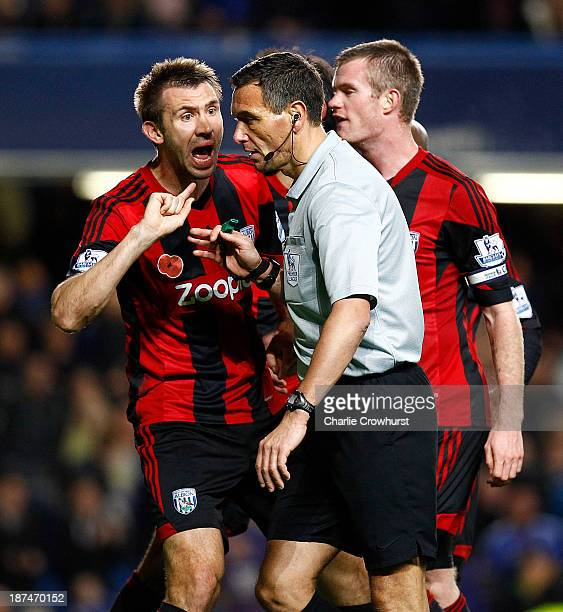 West Brom's Gareth McAuley appeals to referee Andre Marriner after he awards a late penalty to Chelsea during the Barclays Premier League match...