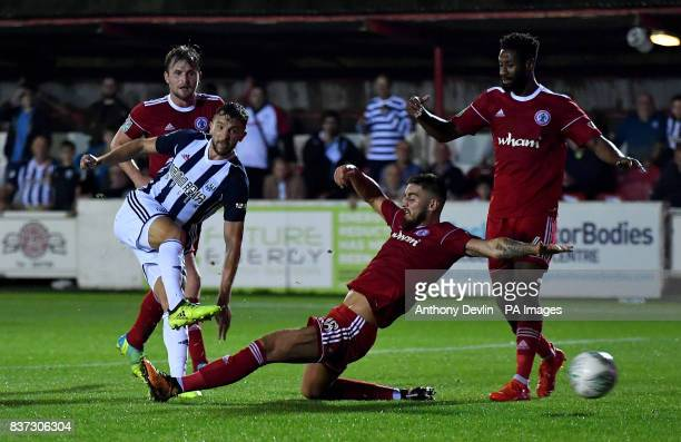 West Brom's Jay Rodriguez scores the third goal during the Carabao Cup Second Round match at the Wham Stadium Accrington