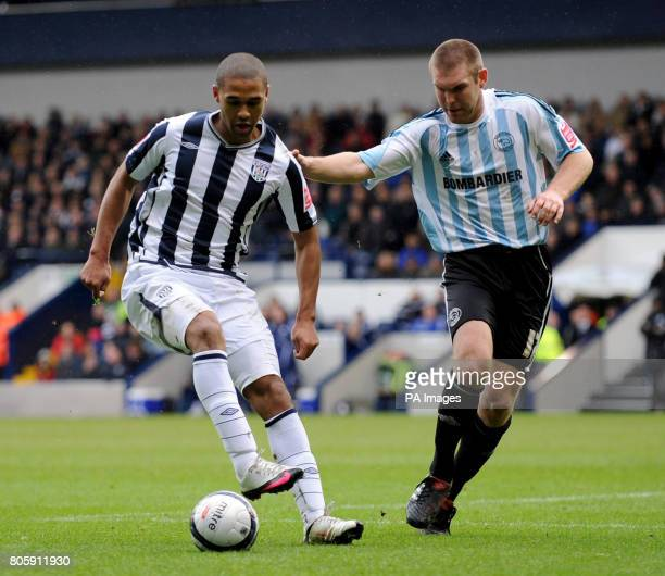 West Brom's Luke Moore and Derby's Jake Buxton battle for the ball during the CocaCola Championship match at The Hawthorns West Bromwich