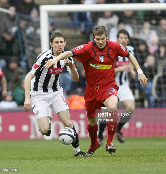 West Brom's Zoltan Gera competes with Colchester's Dean Hammond during the CocaCola Championship match at The Hawthorns West Bromwich