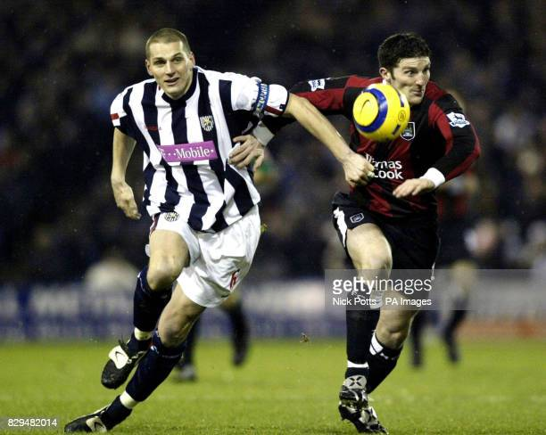West Bromwich Albion defender Darren Purse tussles with Manchester City striker Jon Macken for the ball