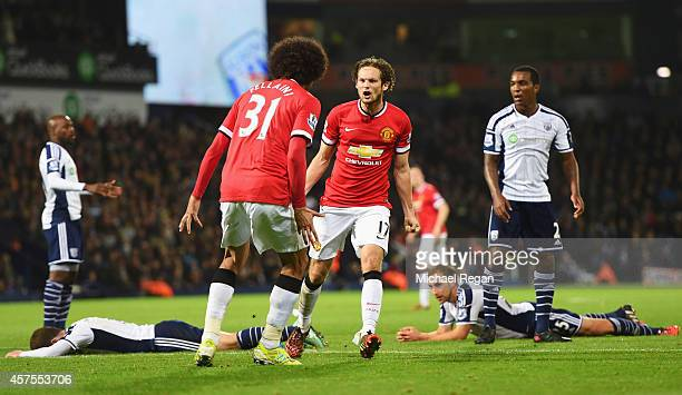 West Bromwich Albion defenders look dejected as Daley Blind of Manchester United celebrates scoring their second and equalising goal with Marouane...