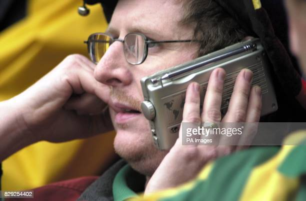 A West Bromwich Albion fan listens silently to his radio as his side go on to win 21 at Sunderland only to find themselves relegated in the...