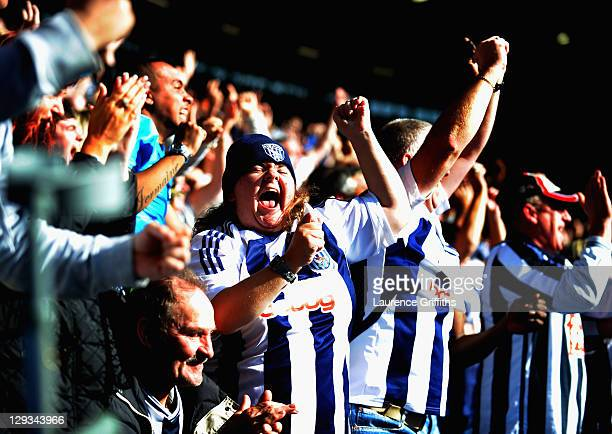 West Bromwich Albion fans celebrate the first goal scored by Chris Brunt during the Barclays Premier League match between West Bromwich Albion and...