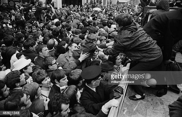 West Bromwich Albion fans lining the street and cheering following the teams win in the FA Cup May 19th 1968