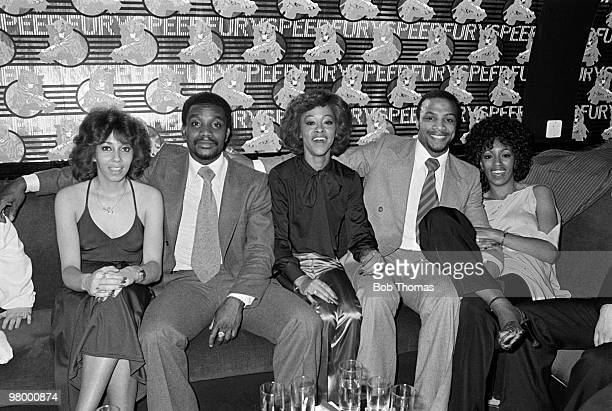 West Bromwich Albion footballers Laurie Cunningham and Cyrille Regis with the American singers The Three Degrees in the VIP area at the Holy City Zoo...