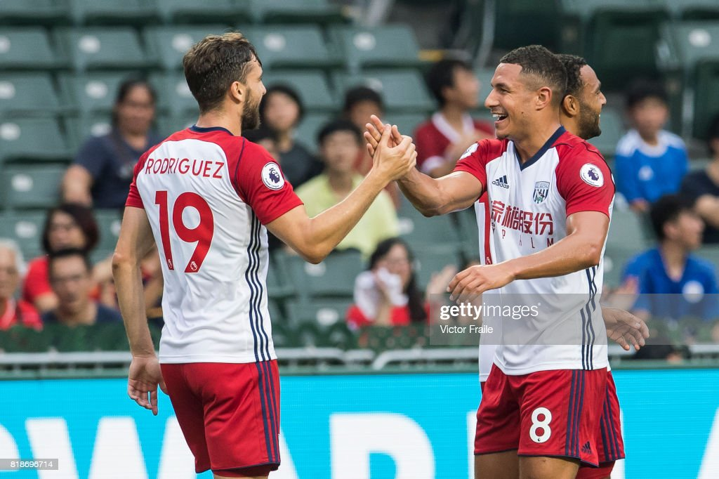 West Bromwich Albion forward Jay Rodriguez (L) celebrates with teammate Jake Livermore (r) during the Premier League Asia Trophy match between Leicester City FC and West Bromwich Albion at Hong Kong Stadium on July 19, 2017 in Hong Kong, Hong Kong.