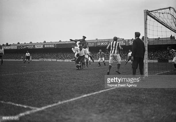 West Bromwich Albion goalkeeper Hubert Pearson misses the ball under pressure from Tottenham Hotspur forwards during a division one match at Spurs'...
