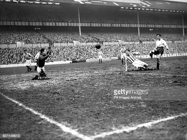 West Bromwich Albion goalkeeper Jimmy Sanders goes down on his knees to save a shot from Tottenham Hotspur's Les Bennett after teammate Jack Vernon...